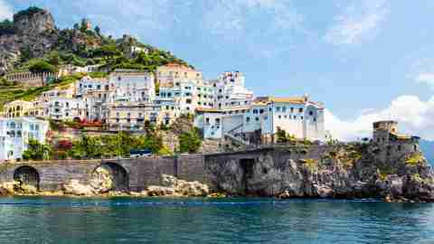 panoramic view of small haven of amalfi village with tiny beach and colorful houses located on rock t20 xXBwg2 scaled 1
