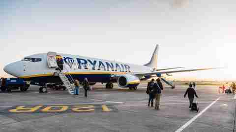 passengers are boarding on ryanair boeing 737 800 airplane in the runway of the dublin airport short t20 bA0bVX scaled 1
