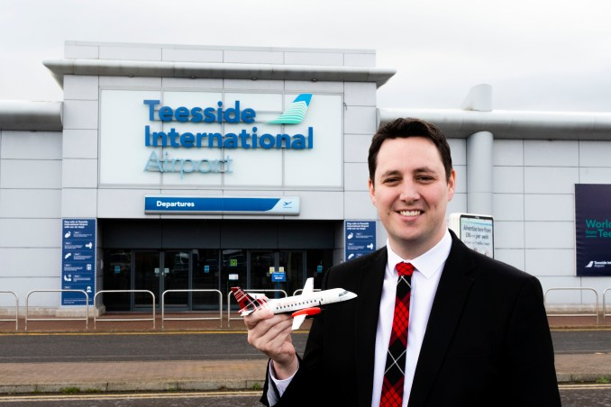 Mayor Ben Houchen outside Teeside Airport with Loganair model