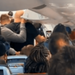 VIDEO: American Airlines passengers fight over who gets off plane first